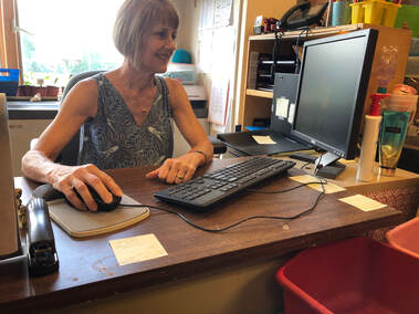 Sue Mulberry at her desk at RCC